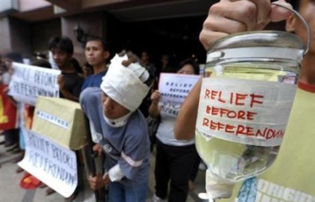 Des manifestants demandent l'autorisation de l'aide internationale avant le référendum - ©AFP